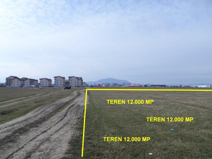 Teren intravilan de vanzare in Brasov, zona Tractorul. Suprafata terenului 12000 metri patrati, deschidere 70 metri. Pret:  EUR.
