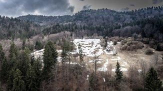 vanzare teren intravilan de la agentie imobiliara cu suprafata de 23000 mp, localitatea Moieciu de Sus