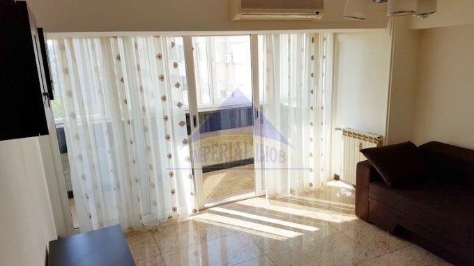 Apartament inchiriere Unirii cu 2 camere, etajul 6 / 7, 1 grup sanitar, cu suprafata de 74 mp. Bucuresti, zona Unirii.