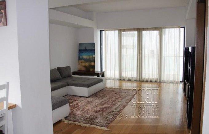 Apartament de inchiriat in Constanta cu 2 camere, cu 2 grupuri sanitare, suprafata utila 100 mp. Pret: 600 euro. Usa intrare: Metal. Mobilat lux.