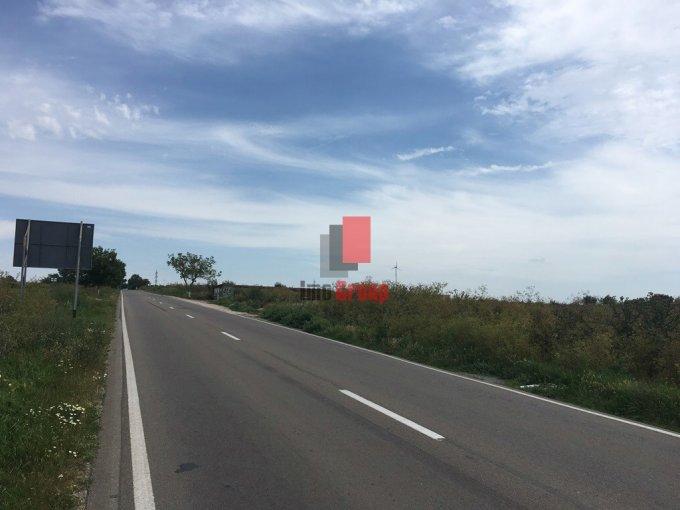 Teren intravilan de vanzare in Agigea. Suprafata terenului 5000 metri patrati, deschidere 21 metri. Pret: 95.000 euro. Destinatie: Comercial, Hala productie, Depozit.