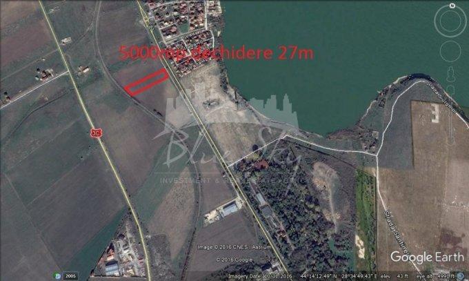 Rezidentiala - malul lacului Teren intravilan vanzare 5000 mp, deschidere 27 metri. Pret: 375.000 euro negociabil. agentie imobiliara vand teren intravilan