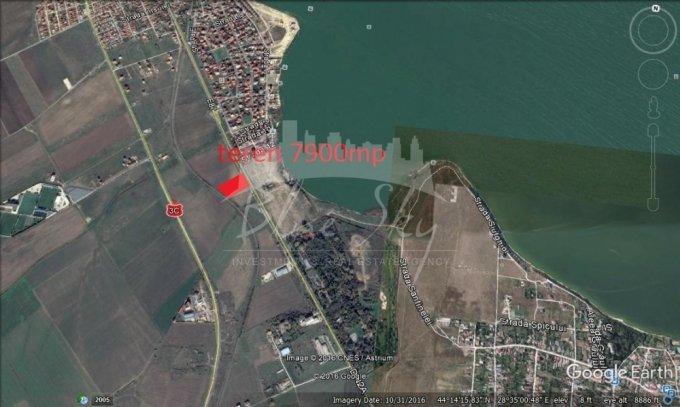Teren intravilan de vanzare in Ovidiu, zona Rezidentiala - malul lacului. Suprafata terenului 7900 metri patrati, deschidere 62 metri. Pret: 592.500 euro negociabil.