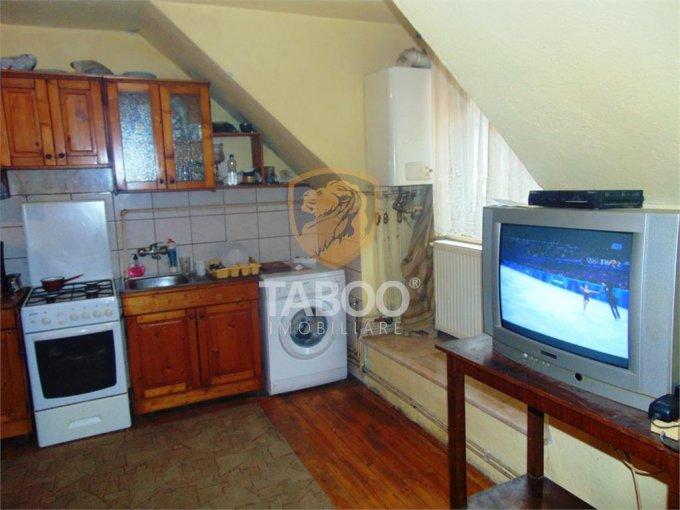 Apartament de vanzare direct de la agentie imobiliara, in Cisnadie, cu 25.000 euro. 1 grup sanitar, suprafata utila 64 mp.
