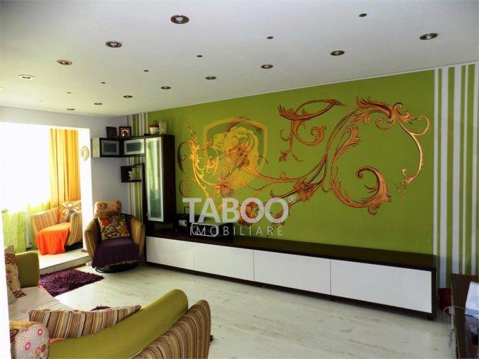 Apartament de vanzare in Sibiu cu 4 camere, cu 2 grupuri sanitare, suprafata utila 78 mp. Pret: 95.000 euro.