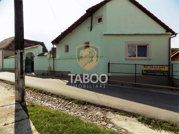 Casa de vanzare in Talmaciu cu 2 camere, cu 1 grup sanitar, suprafata utila 90 mp. Suprafata terenului 1200 metri patrati, deschidere 25 metri. Pret: 65.000 euro. Casa
