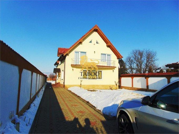 Casa de vanzare in Sibiu cu 4 camere, cu 2 grupuri sanitare, suprafata utila 230 mp. Suprafata terenului 1400 metri patrati, deschidere 14 metri. Pret: 335.000 euro. Casa