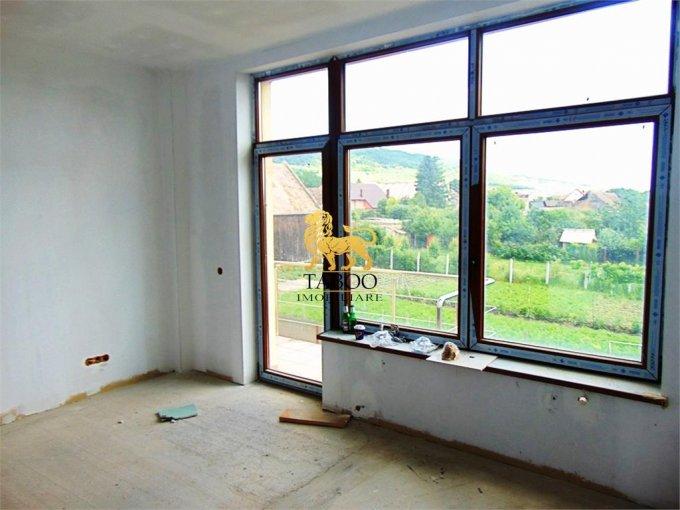 vanzare Casa Sibiu Gusterita cu 6 camere, 4 grupuri sanitare, avand suprafata utila 186 mp. Pret: 79.900 euro. agentie imobiliara vand Casa.