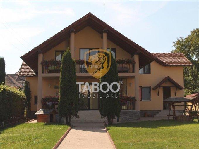Casa de vanzare direct de la agentie imobiliara, in Cisnadie, cu 250.000 euro. 4 grupuri sanitare, suprafata utila 345 mp. Are  8 camere.